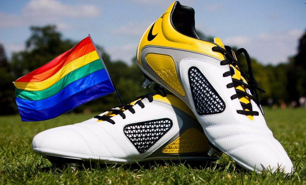 Picture of he rainbow flag and a pair of football boots